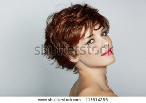 stock-photo-beautiful-young-woman-with-red-hair-wearing-short-pixie-crop-hairstyle-on-studio-background-118614265
